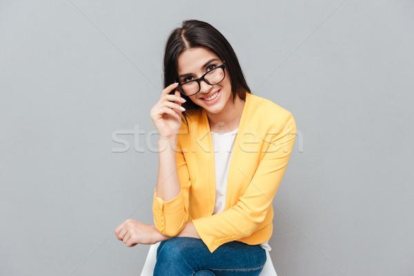 довольно Lady сидят стул серый прикасаться Сток-фото © deandrobot