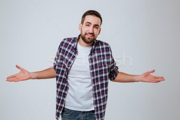 Uncomprehending Bearded man in shirt Stock photo © deandrobot