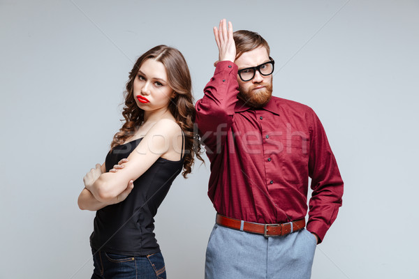 Displeased woman with male nerd Stock photo © deandrobot