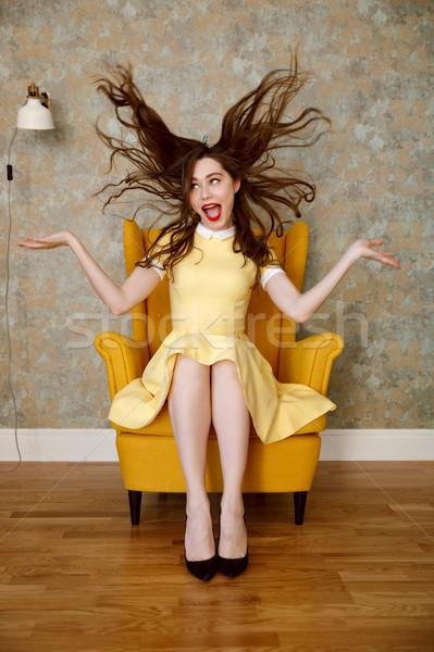 垂直 画像 クレイジー 女性 アームチェア 黄色 ストックフォト © deandrobot