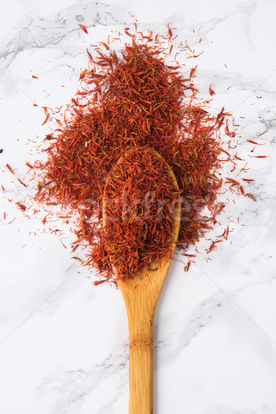 Saffron spice in wooden spoon isolated Stock photo © deandrobot