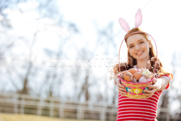 Portrait of a happy red head girl wearing bunny ears Stock photo © deandrobot