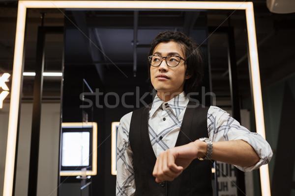 удивительный молодые азиатских человека очки Сток-фото © deandrobot
