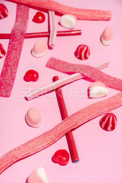 Colorful mix of pink and red sugar candies and lollies Stock photo © deandrobot