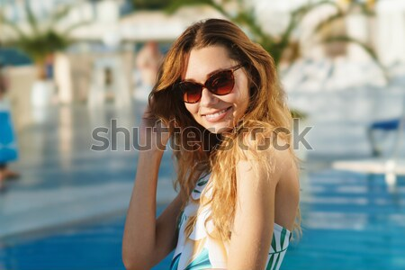 View from back of girl with her friend Stock photo © deandrobot