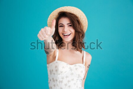 Scary angry woman in straw hat making cat claws gesture Stock photo © deandrobot