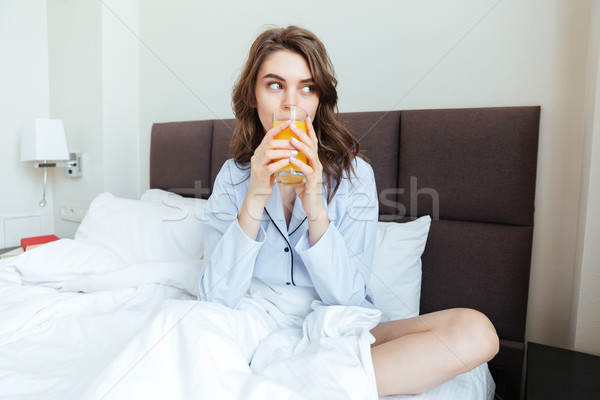 Portrait of a young pretty woman wearing nightwear Stock photo © deandrobot