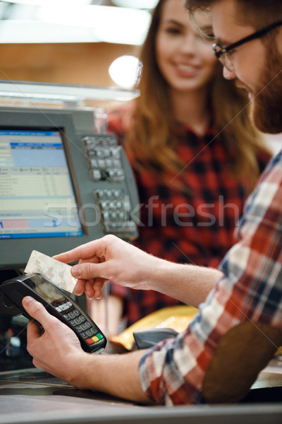 Cashier man on workspace create payment Stock photo © deandrobot