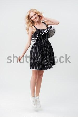 Retrato mujer sonriente vestido sonriendo mujer rubia Foto stock © deandrobot