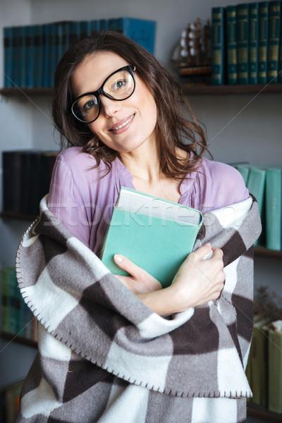Mosolyog érett nő fedett pléd tart könyv Stock fotó © deandrobot