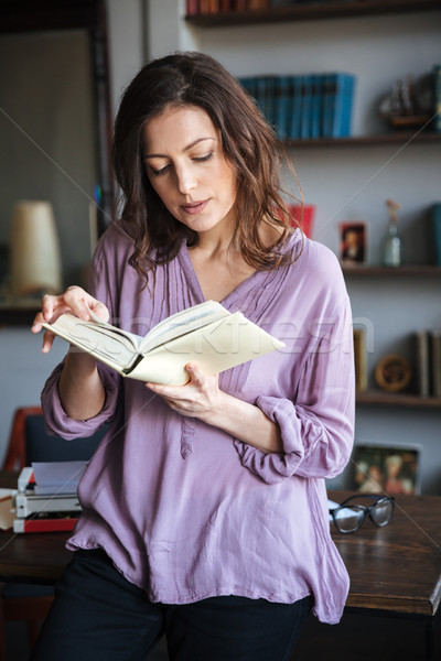 Portrait of a thoughtful mature woman reading book Stock photo © deandrobot