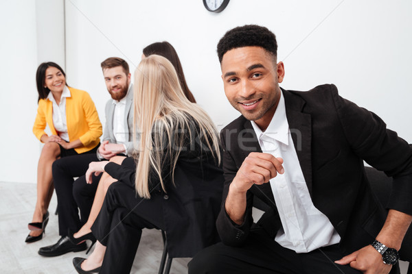 Colleagues sitting in office talking with each other Stock photo © deandrobot