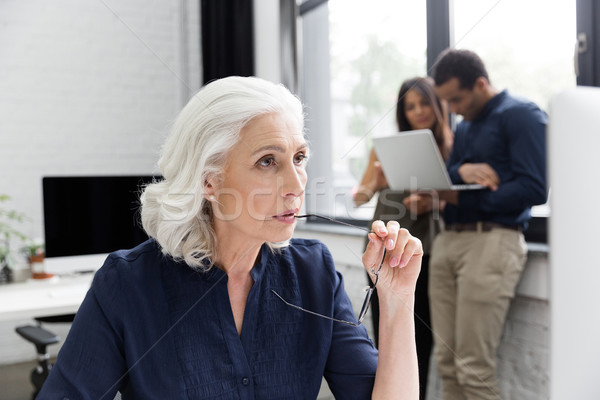 Dalgın iş kadını çalışma işyeri ofis kadın Stok fotoğraf © deandrobot