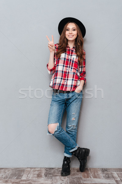 Portrait of a young attractive casual girl in plaid shirt Stock photo © deandrobot