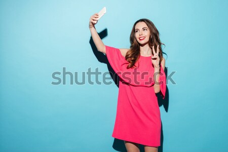 Happy young brunette woman pointing catch the car Stock photo © deandrobot