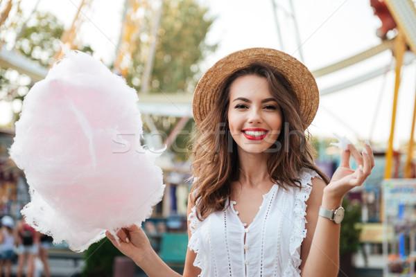 幸せ 笑みを浮かべて 少女 綿 キャンディ 公園 ストックフォト © deandrobot