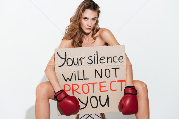 Naked woman in boxing gloves sitting with broadsheet Stock photo © deandrobot