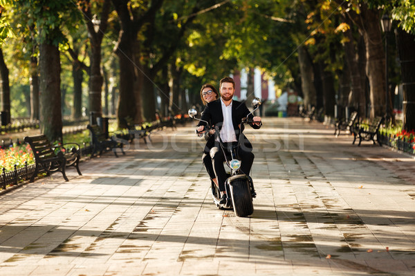 Full length image of elegant couple rides on modern motorbike Stock photo © deandrobot