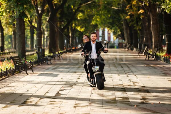 Image élégante couple modernes moto Photo stock © deandrobot
