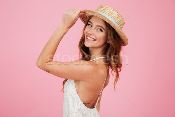 Portrait of a smiling attractive woman in summer dress Stock photo © deandrobot