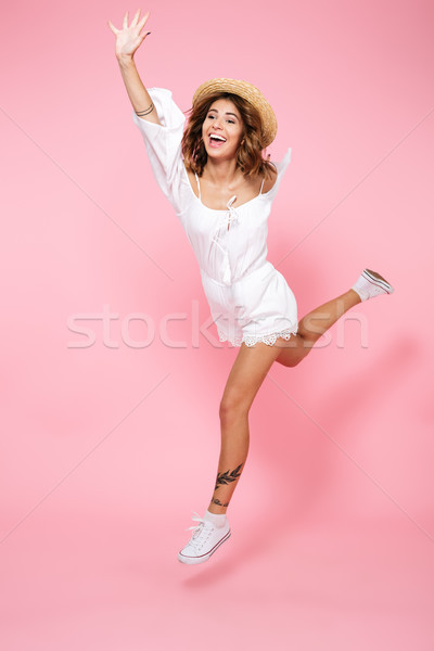 Full length portrait of a happy pleased girl Stock photo © deandrobot