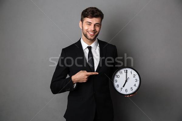 Stockfoto: Aantrekkelijk · zakenman · klassiek · zwart · pak · wijzend · vinger