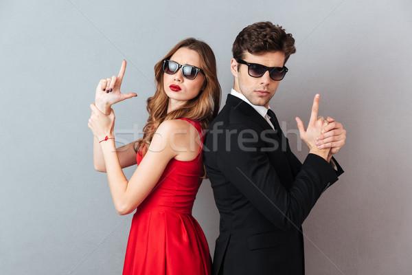 Portré komoly fiatal pér hivatalos visel napszemüveg Stock fotó © deandrobot