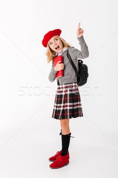 Full length portrait of a cheery little schoolgirl Stock photo © deandrobot