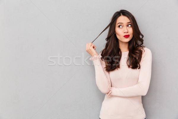 Retrato jóvenes mujer tocar bloqueo pelo Foto stock © deandrobot