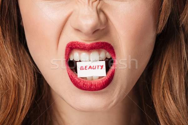 Close up portrait of a furious brown haired woman Stock photo © deandrobot