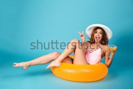 Full length portrait of a funny girl dressed in swimsuit Stock photo © deandrobot