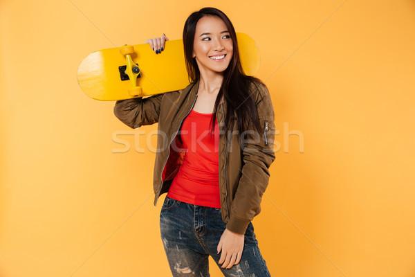 Portrait of a cheery pretty girl posing Stock photo © deandrobot