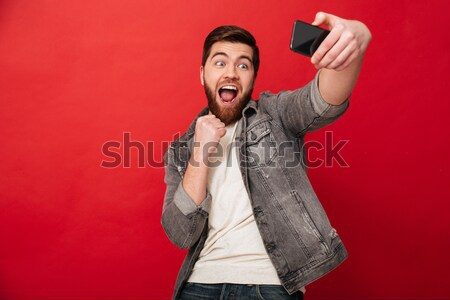 Cheerful punk woman screaming and showing rock gestures Stock photo © deandrobot