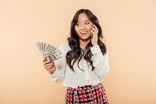 Portrait of a cheerful asian woman Stock photo © deandrobot