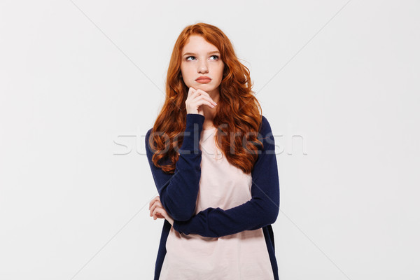 Thoughtful young redhead lady. Looking aside. Stock photo © deandrobot
