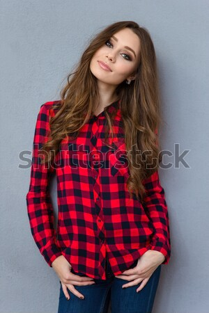 Portrait of a satisfied cheery girl counting money banknotes Stock photo © deandrobot