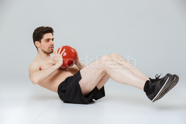 Portrait of a concentrated young half naked sportsman Stock photo © deandrobot