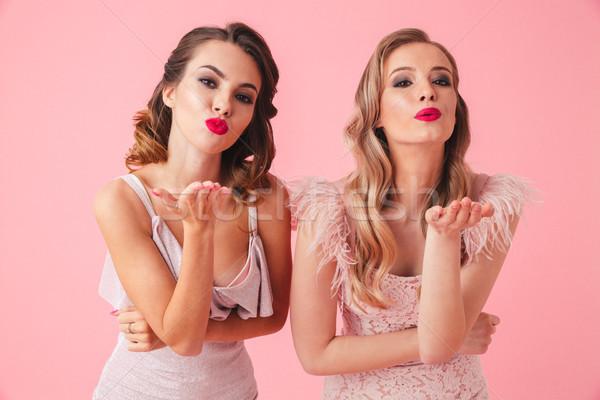 Two lovely women in dresses sends air kisses Stock photo © deandrobot