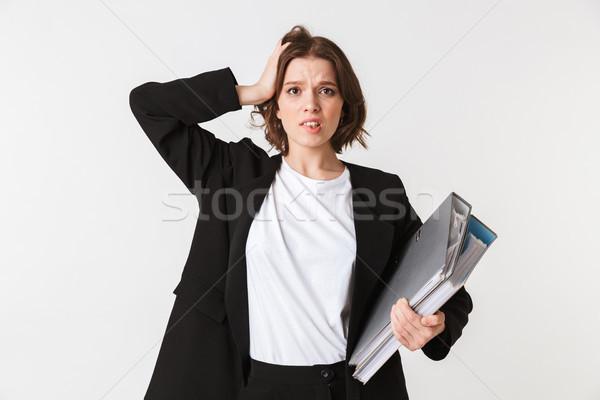 Ritratto confusi giovani imprenditrice nero giacca Foto d'archivio © deandrobot