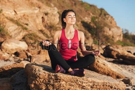 счастливым молодые сидят йога положение Сток-фото © deandrobot