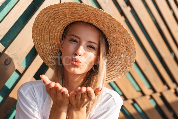 Portrait of glamour seductive woman 20s in straw hat and swimwea Stock photo © deandrobot