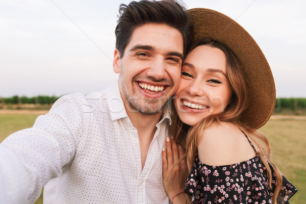 Lovely smiling couple man and woman dating, and taking selfie to Stock photo © deandrobot