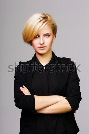 Belle jeune femme bras pliées gris femme Photo stock © deandrobot