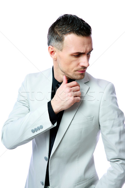 Pensive businessman looking away isolated on a white background Stock photo © deandrobot