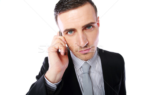 Business man talking on his mobile phone over white background Stock photo © deandrobot