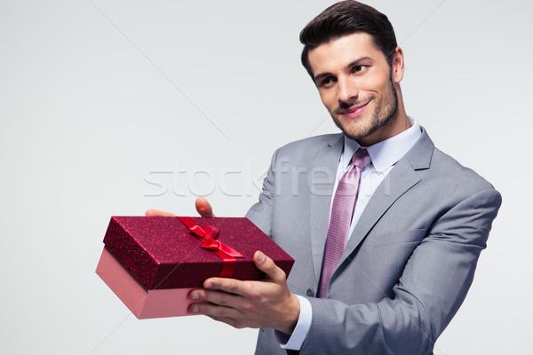 Businessman giving gift box Stock photo © deandrobot