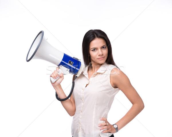 Belo empresária em pé megafone branco olhando Foto stock © deandrobot