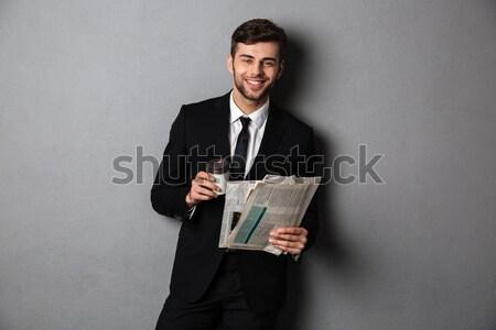 Businessman holding gift box Stock photo © deandrobot