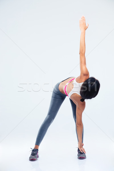 Full length portrait of a sporty woman stretching Stock photo © deandrobot