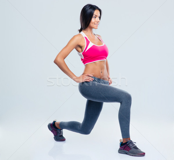 Sports woman stretching legs  Stock photo © deandrobot